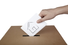 close up of hand and voting ballot
